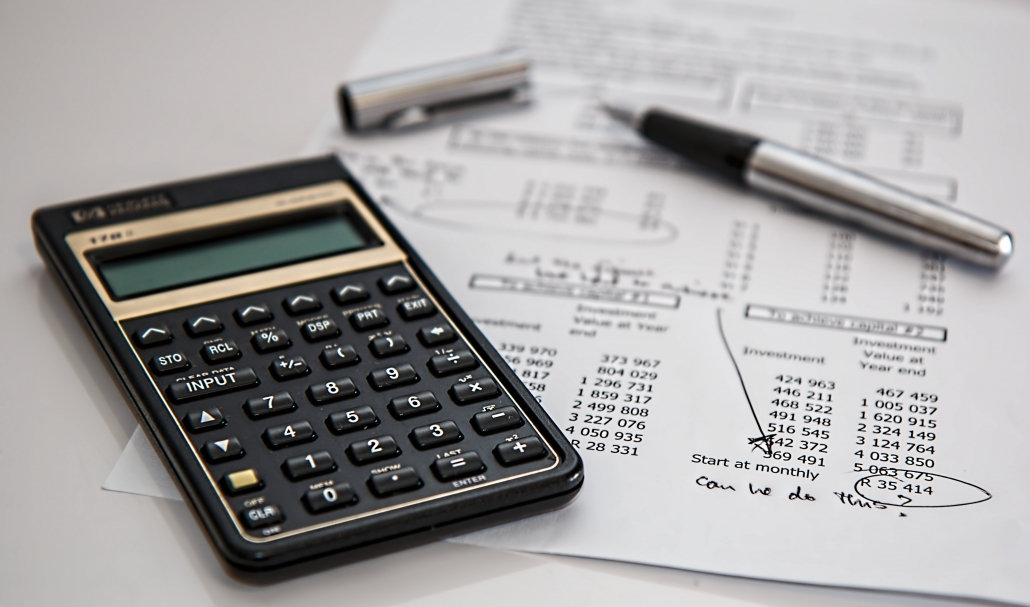 calculator and receipts - Tax Preparation help from GMA