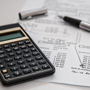 calculator and receipts - tax preparation