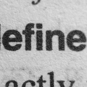 "the word ""defined"" in a dictionary page"